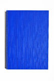 Blaues Notizbuch getrennt Stockfotografie