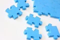 Blaues Puzzlespiel Stockfotos