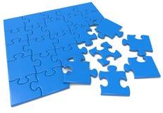 Blaues Puzzlespiel Stockbilder