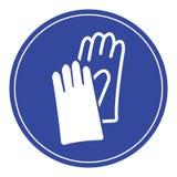 Blaues Schutzhandschuhezeichen stockfoto