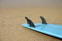 Blaues Surfbrett Stockfoto