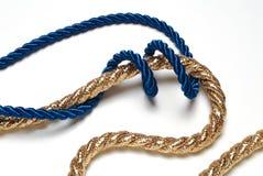 Blaues und goldenes Seil Stockfotografie