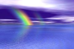 Blaues wayter und Regenbogen Stockfotos