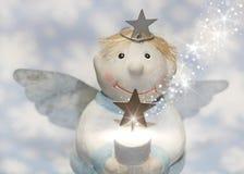 Blaues Weihnachten oder Schutzengel mit Schneeflocken für Dekoration Lizenzfreie Stockfotos