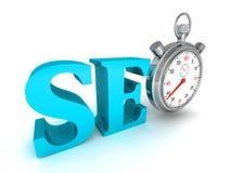 Blaues Wort und Stoppuhr Seo auf weißem Hintergrund Lizenzfreies Stockfoto