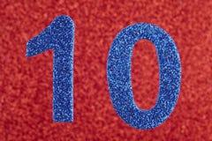 Blaufarbe der Nr. zehn über einem roten Hintergrund jahrestag Lizenzfreie Stockbilder