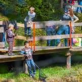 Blausee, Switerland - piccoli pescatori III Fotografie Stock Libere da Diritti