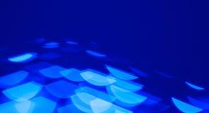 Blauw bokehlicht op zwarte achtergrond Stock Afbeeldingen