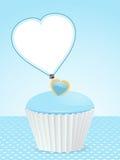 Blauw cupcakeachtergrond en berichtetiket Stock Foto's
