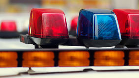 Blauw en de Politiewagen van Rood lichten Stock Afbeeldingen