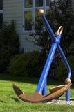 Blauw en Gouden Anker stock afbeelding