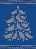Blauw gebreid patroon met een Kerstboom royalty-vrije stock foto's