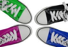 Blauw, groen, roze en zwarte tennisschoenen Royalty-vrije Stock Afbeeldingen