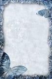 Blauw ijsframe met vlindersachtergrond Stock Afbeelding