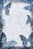 Blauw ijsframe met vlindersachtergrond Royalty-vrije Stock Foto