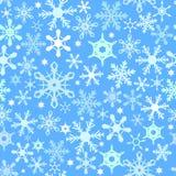Blauw naadloos sneeuwvlokpatroon Stock Afbeeldingen