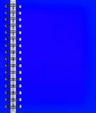 Blauw notitieboekje Stock Foto's