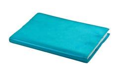 Blauw notitieboekje op witte achtergrond Stock Foto's