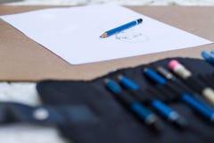 Blauw potlood met tekeningsdocument Royalty-vrije Stock Afbeeldingen