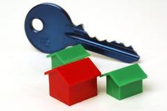 Blauw sleutel en huis Royalty-vrije Stock Afbeeldingen