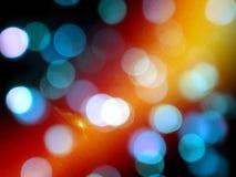 Blauw vaag om lichten met en oranje heldere gloed op een zwarte achtergrond royalty-vrije stock foto