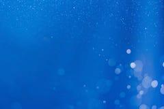 Blauwe abstracte lichte bokehachtergrond Stock Afbeeldingen