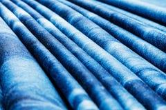 Blauwe achtergrond, de achtergrond van denimjeans Jeanstextuur, stof royalty-vrije stock afbeeldingen