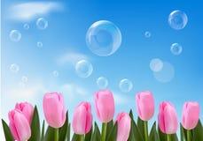 Blauwe achtergrond met realistische bellen en bloemen Royalty-vrije Stock Foto