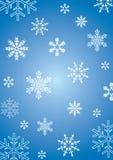 Blauwe achtergrond met Sneeuwvlokken Stock Afbeeldingen