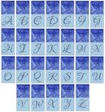 Blauwe alphabeth met vrouw Stock Afbeeldingen