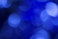Blauwe bokehachtergrond Royalty-vrije Stock Afbeeldingen