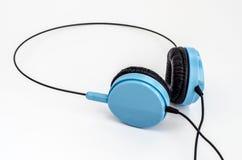 Blauwe compacte hoofdtelefoons Stock Fotografie