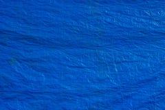 Blauwe de textuurachtergrond van de geteerde zeildoekenstof Stock Foto's