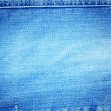 Blauwe denimachtergrond Stock Foto's