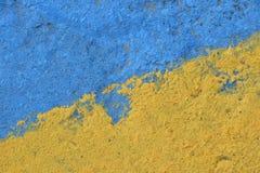 Blauwe en gele geschilderde concrete muurtextuur Royalty-vrije Stock Afbeelding