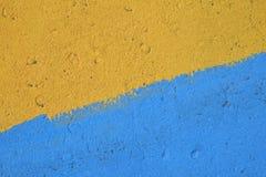 Blauwe en gele geschilderde concrete muurtextuur Royalty-vrije Stock Fotografie