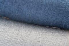 Blauwe en grijze achtergrond van draden Stock Foto