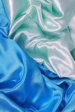 Blauwe en lichtgroene Zijdedoek van golvende abstracte achtergronden Stock Foto