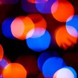 Blauwe en oranje bokehlichten Stock Afbeeldingen