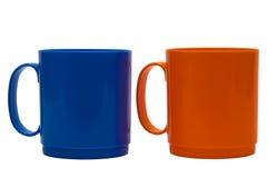 Blauwe en oranje mok stock afbeeldingen