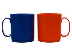 Blauwe en oranje mok royalty-vrije stock afbeeldingen
