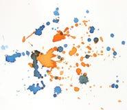 Blauwe en oranje waterverfplons als achtergrond Stock Afbeelding