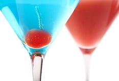 Blauwe en Rode Cocktails stock afbeelding