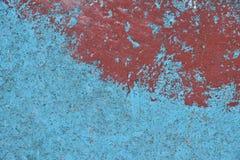 Blauwe en rode geschilderde concrete muurtextuur Stock Afbeeldingen
