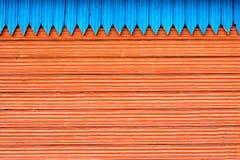 Blauwe en rode houten planken Stock Foto's