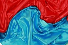 Blauwe en rode Zijdedoek van golvende abstracte achtergronden Royalty-vrije Stock Foto
