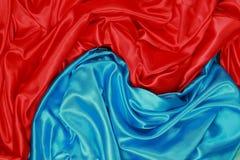 Blauwe en rode Zijdedoek van golvende abstracte achtergronden Stock Foto