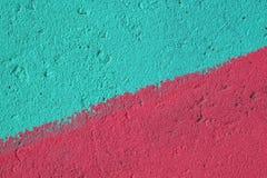 Blauwe en roze geschilderde concrete muurtextuur Stock Afbeeldingen