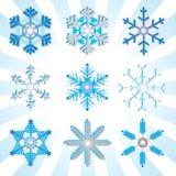 Blauwe en zilveren gedetailleerde sneeuwvlokkenvariaties Royalty-vrije Stock Afbeeldingen