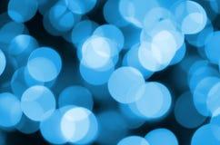 Blauwe Feestelijke Kerstmis elegante abstracte achtergrond met vele bokehlichten Defocused artistiek beeld Stock Afbeeldingen